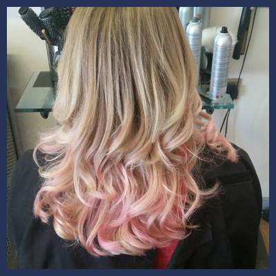 Blonde hair with subtle pink tips